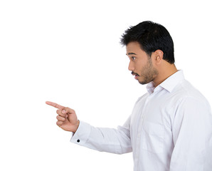 Serious man pointing finger at someone, copy space