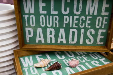 Welcome to paradise sign.