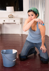 Housekeeper Takes A Break Scrubbing the Floor