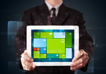 Businessman holding a tablet with modern software operational sy