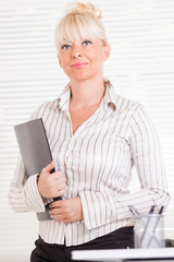 Business woman standing in the office with document
