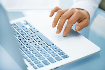 Close-up of hand woman using a laptop computer