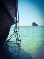 The ladder from wooden boat to the sea