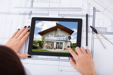 Architect With Digital Tablet And Blueprint