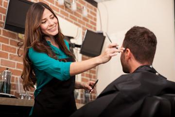 Lady barber cutting hair