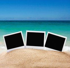 photo frames on the sea sand on the beach