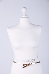 Straps on mannequin on grey background close-up