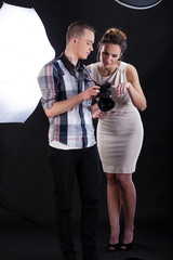 Model and photographer analysing a photo