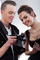 Model and photographer watching photos