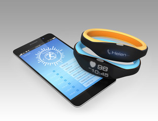 Smart wristbands and smartphone on gray background