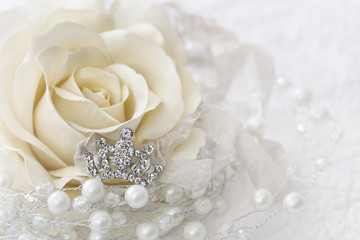 Cream color rose with jeweled crown