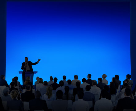 Group Of Business People Listening To A Speech