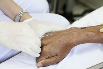 Doctor drawing blood sample from arm for blood test