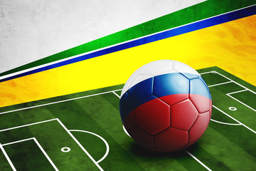 Soccer ball with Russia flag on pitch