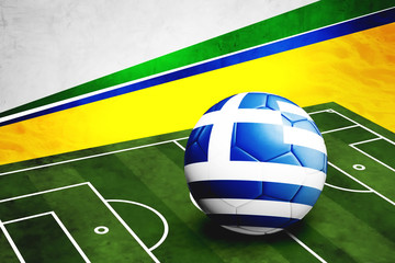 Soccer ball with Greece flag on pitch
