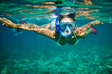 Fototapeta Young women at snorkeling in the tropical water obraz
