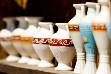 several souvenir amphoras