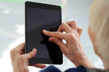 Elderly woman with tablet