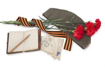 Carnations, George ribbon, field cap and old letters