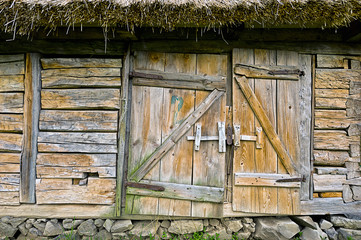 Abandoned barn vintage wooden door. Photo of rustic house entran