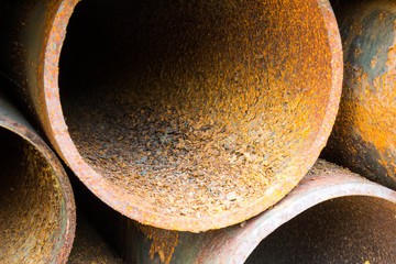 Part of rusty old pipes stacked up with natural light