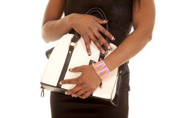 African American woman black dress body close purse