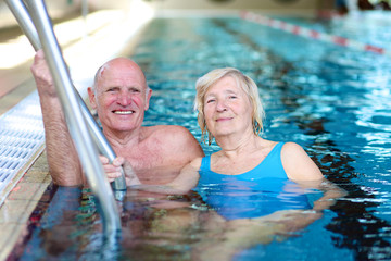Happy couple of seniors enjoying in swimming pool