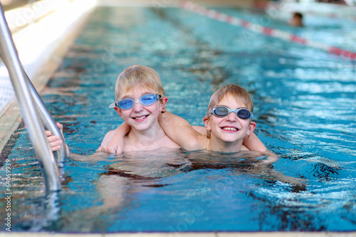 Twin Brothers Having Fun In Swimming Pool Stock Photo And Royalty Free Images On