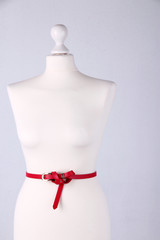 Strap on mannequin on grey background close-up