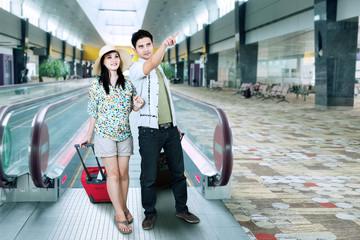 Tourist on escalator at airport