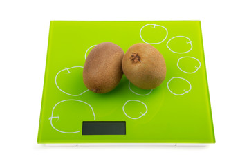 Two kiwi fruit on scales