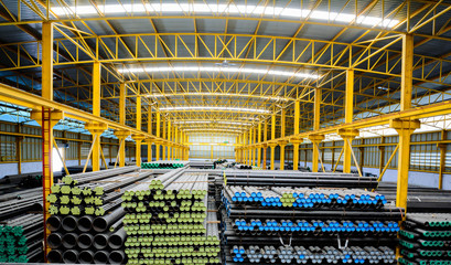 Steel pipes storage in warehouse for construction