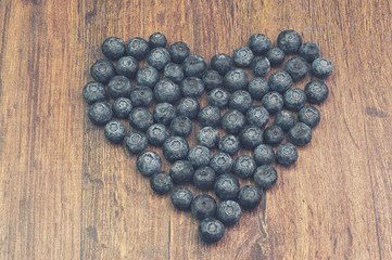 Blueberries on the table in a shape of a heart