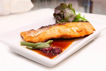 Grilled salmon with teriyaki sauce on the table