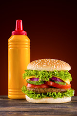 Wall Mural - Homemade burger on the wooden table