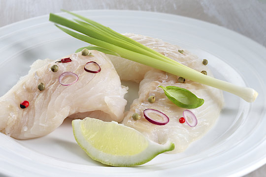 ready to cook raw cod filet ion a plate