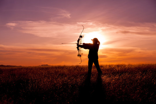 Woman Bowhunter in Sunset