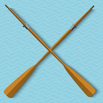 Two wooden oars on wavy background