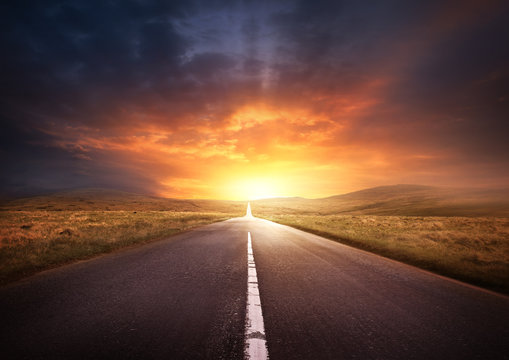 Road Leading Into A Sunset