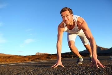 Sprinter starting sprint - man running