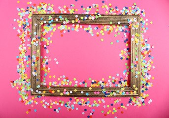Photoframe with confetti on pink background