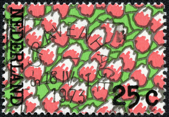 Stamp printed in Netherlands shows Red tulips pattern