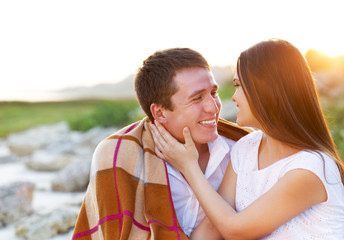 Happy couple in love in summer day. Outdoors portrait