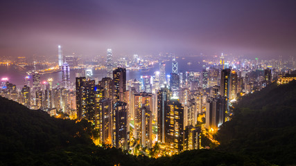Hong Kong skyline at mist over Victoria Peak.