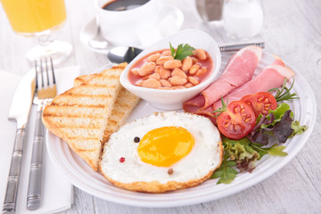 fried egg with toast and beans