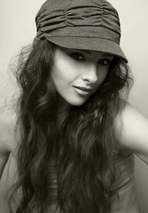 Sexy female model in cap. Black and white portrait