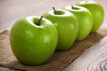 Green Apples on a Burlap