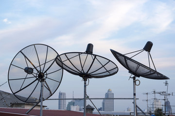satellite dishes antenna on roof top among the city