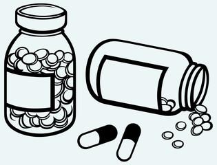 Pill bottle. Spilling pills on to surface