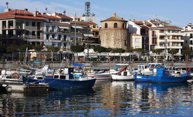 the port with yachts and boats and waterfront cafes in the resor